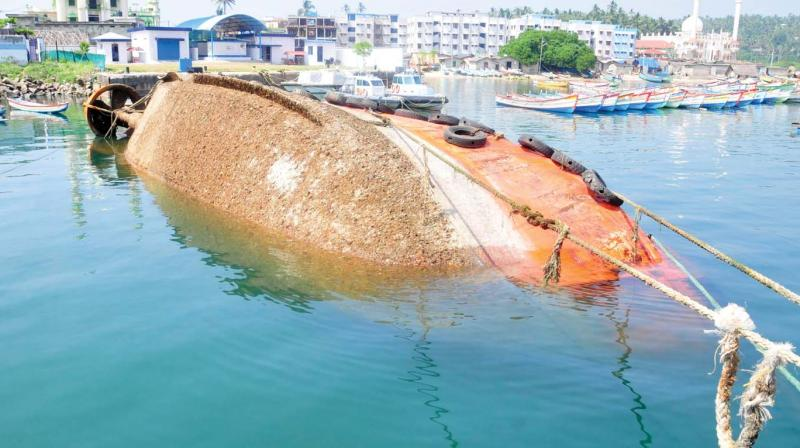 MV Brahmekshara, the abandoned tugboat, which sank spilling fuel and oil at Seaward Wharf of Vizhinjam Port on Wednesday. (Photo: A.V.MUZAFAR )