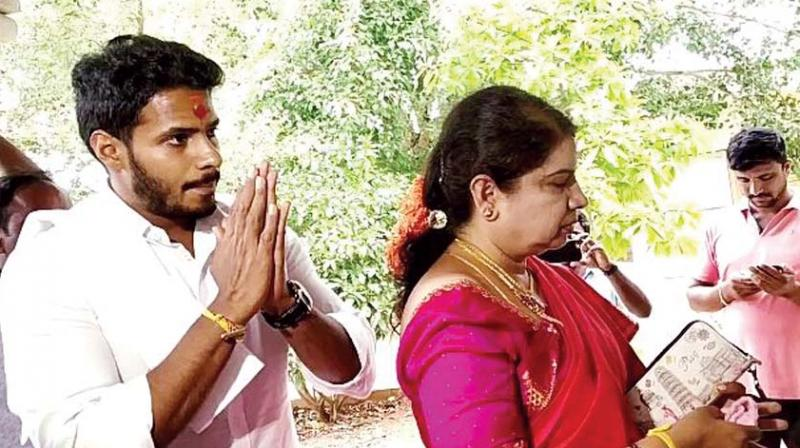 Mandya JD(S) candidate Nikhil Kumaraswamy and mother Anitha on a visit to temples in Hassan and Chikkamagaluru on Wednesday.