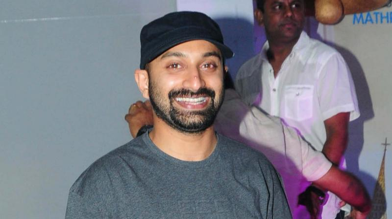 It is the first day of his movie Carbon's release and Fahadh looks happy.