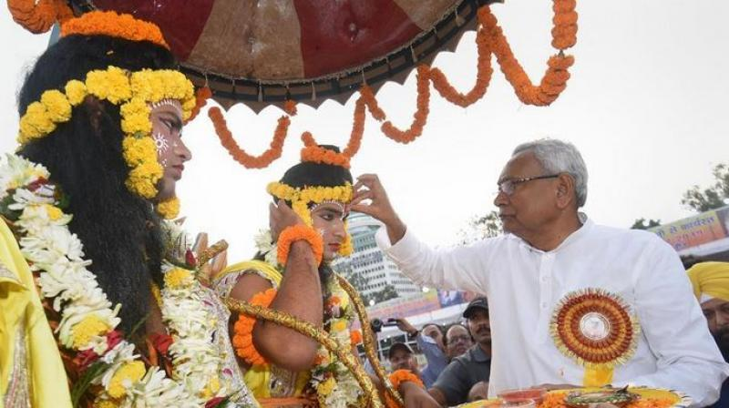 Nevertheless, the chief minister – flanked by senior political figures like assembly Speaker Vijay Kumar Chaudhary and state Congress president and MLC Madan Mohan Jha – took to the dais erected for the festivities at the assigned hour and kicked off the ceremony by lighting lamps (Photo: PTI)