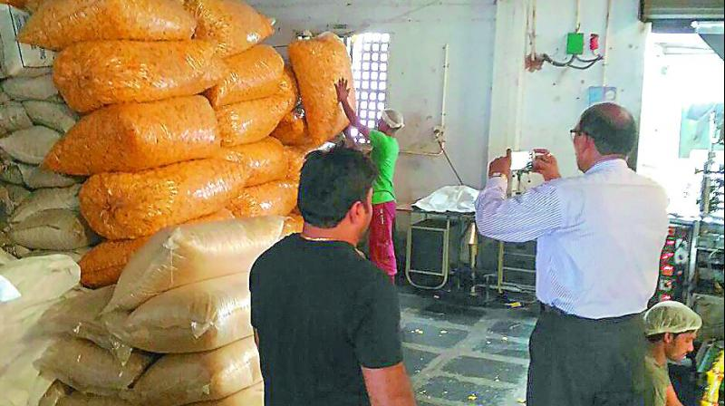 Vigilance CI Venkateswara Rao inspects stock at a food manufacturing unit in Vijayawada on Thursday. (Photo: DC)