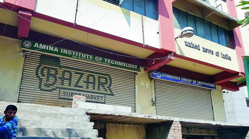 Six of the nine coaching institutions work from this UNI building situated at AC Guards. There were two locked and shuttered doors side by side, indicate remnants of two institutions with signboards indicating that one was the Amina Institute of Technology and the other the Symbiosis Group of Institutions.