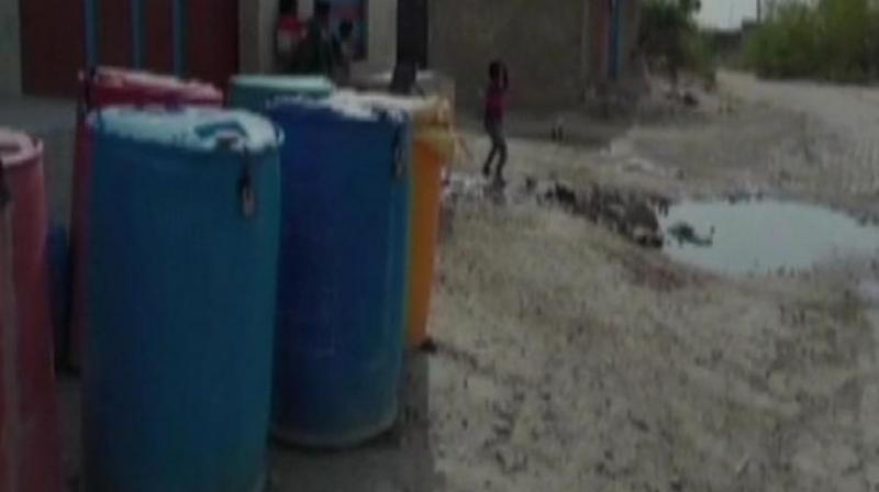 'Due to acute shortage of water, there have been cases of water theft at night a couple of times. So, we have decided to put locks in our drums to save our share of water,' a local said. (Photo: ANI)