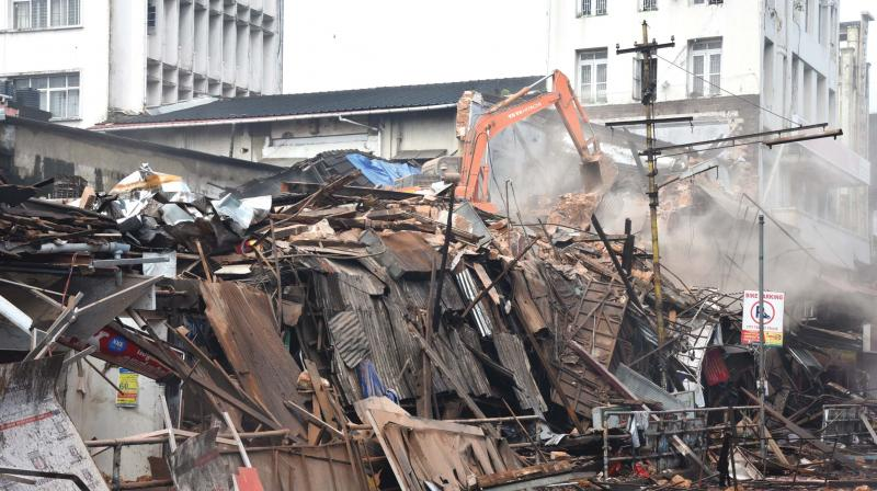 The century old three-storey  was demolished after a portion of it collapsed on Sunday.