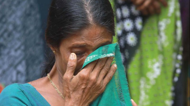Kunnukara panchayat member Liji weeps while listening to the hardships of inmates in relief camps.