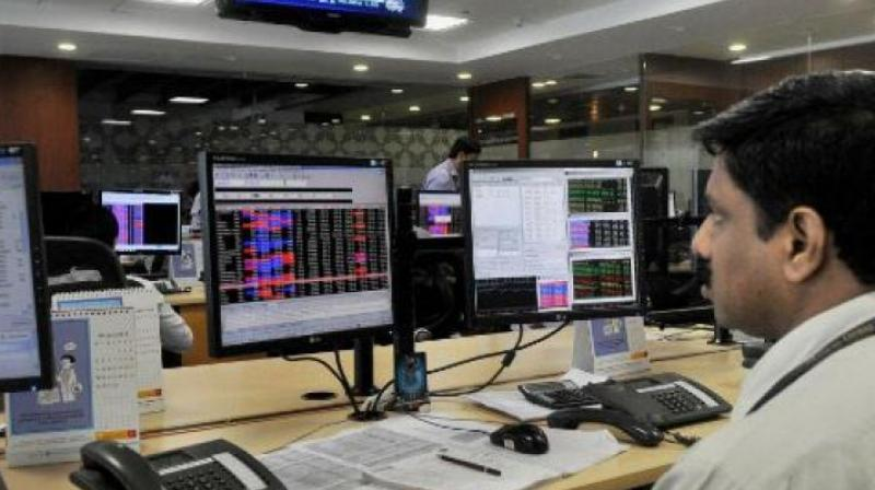 The 30-share Sensex opened lower at 35,452.35 points and moved between 35,241.63 and 35,543.89.