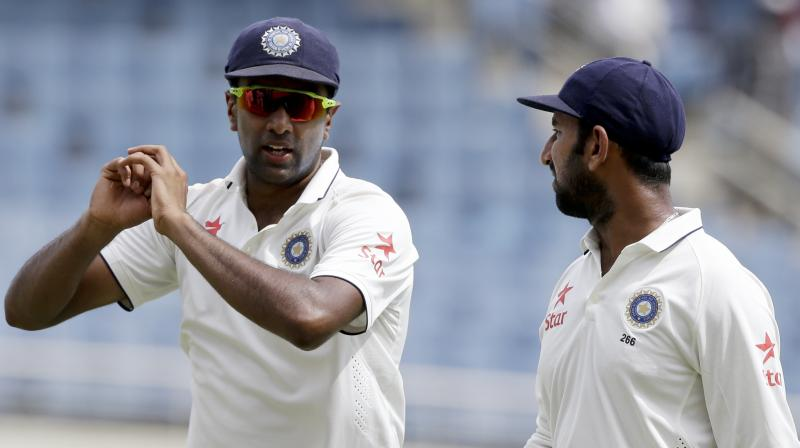 Cheteshwar Pujara has thrown his weight behind star spinner Ravi Ashwin, saying he has made changes he believes will help him finally enjoy success in Australia in the four-test series starting in Adelaide. (Photo: AP)