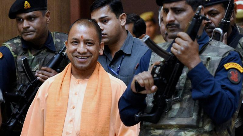 UP Chief Minister Yogi Adityanath coming out after the cabinet meeting at Lok Bhawan in Lucknow. (Photo: PTI)