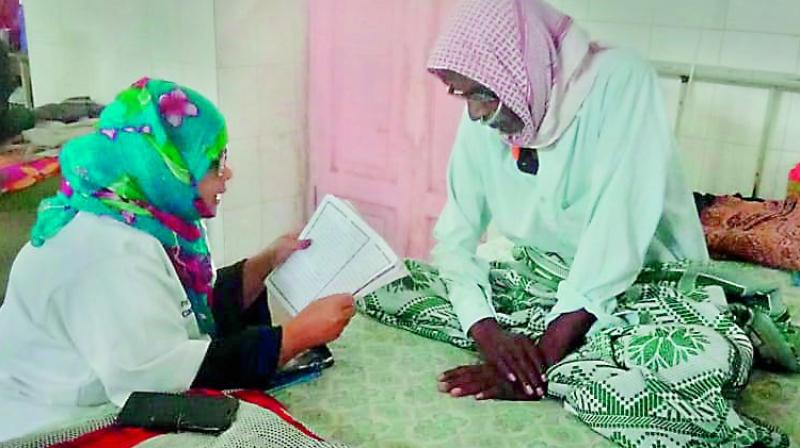A volunteer reading stories from books to patients at the Nizamia Unani Hospital at Charminar.