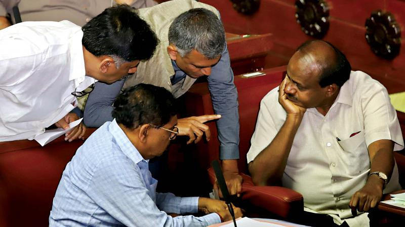 Chief Minister H.D. Kumaraswamy in discussion with DyCM Dr G. Parameshwar and Ministers Krishna Byre Gowda and D.K. Shivakumar during Assembly session at Vidhana Soudha in Bengaluru on Monday (Image DC)