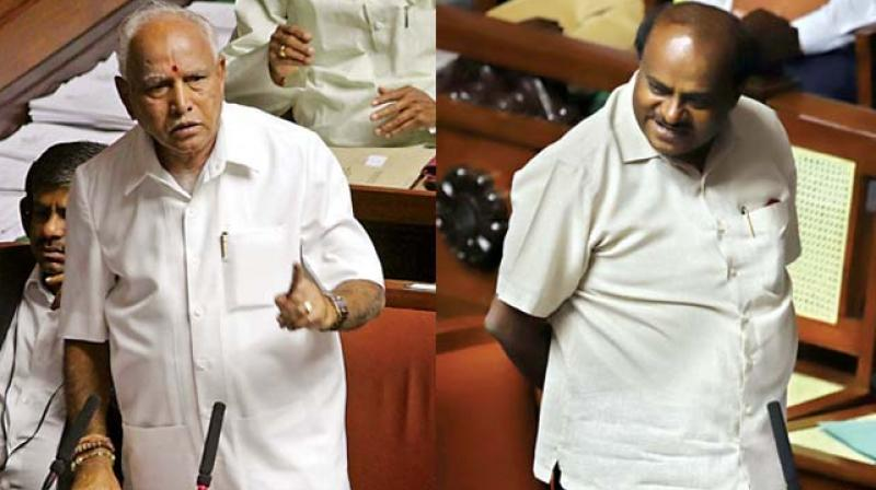 State BJP chief B.S. Yeddyurappa and Chief Minister H.D. Kumaraswamy speak during the Assembly session in Bengaluru on Monday (Image DC)