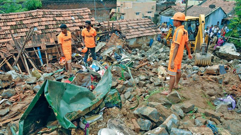 Tamil Nadu Disaster Response Force personnel carry out rescue work at the site of the wall collapse in Nadur village of Mettupalayam taluk, near Coimbatore, Monday.  (PTI)