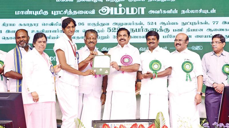 Chief Minister Edappadi, accompanied by Deputy Chief Minister O Panneerselvam, Health Minister C. Vijayabaskar and other ministers at the event on Monday.(DC)