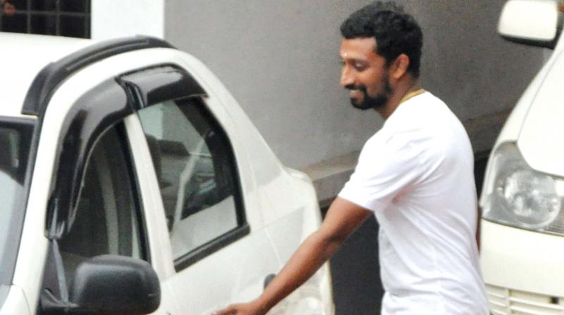 Sunil Raj aka Appunni comes out of Aluva Police Club on Monday. (Photo: DC)