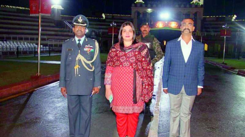 Wing Commander Abhinandan, an Indian Air Force official with Dr Fareha Bugti, director (India) at the Pakistan foreign office, before crossing over the Wagah Border.  (Via Web)