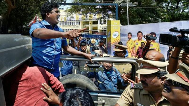 Police detain activists of Tamizhaga Vazhvurimai Katchi who were staging an anti-IPL protest outside MAC Stadium in Chennai on Tuesday. (Photo: PTI)
