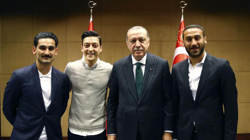 The photos, which show Mesut Ozil and Ilkay Gundogan standing next to the Turkish president Tayyip Erdogan unleashed a storm of criticism from lawmakers across Germany's political spectrum and the DFB football federation, all of whom argued that Erdogan does not sufficiently respect German values. (Photo: AP)