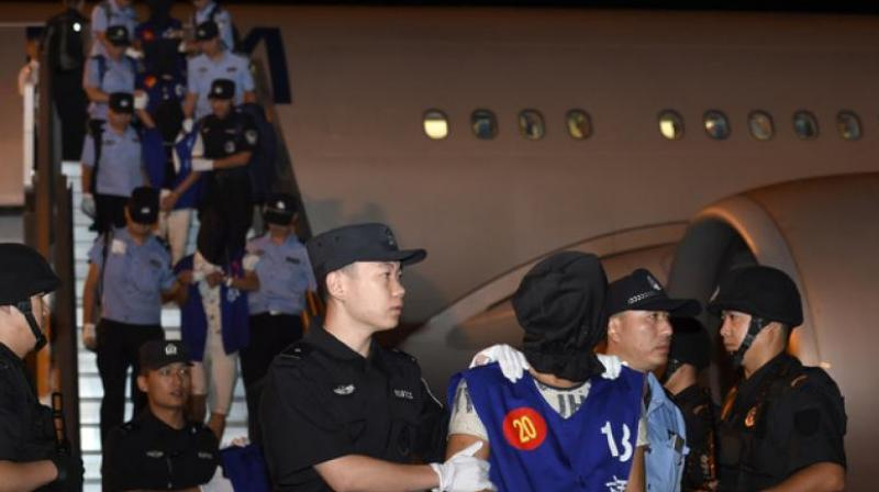 Beijing insists that Taiwanese fraud suspects should be sent to China to face trial because their telecom fraud crimes largely target mainland Chinese. (Photo: AFP)