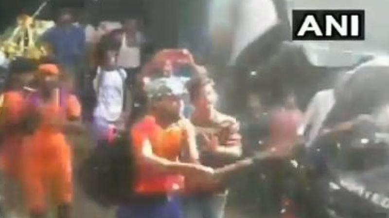 Kanwariyas were filmed attacking a police van on a busy road, and also indulged in an altercation with the locals in Uttar Pradesh's Bulandshahr district. (Photo: ANI/Twitter)