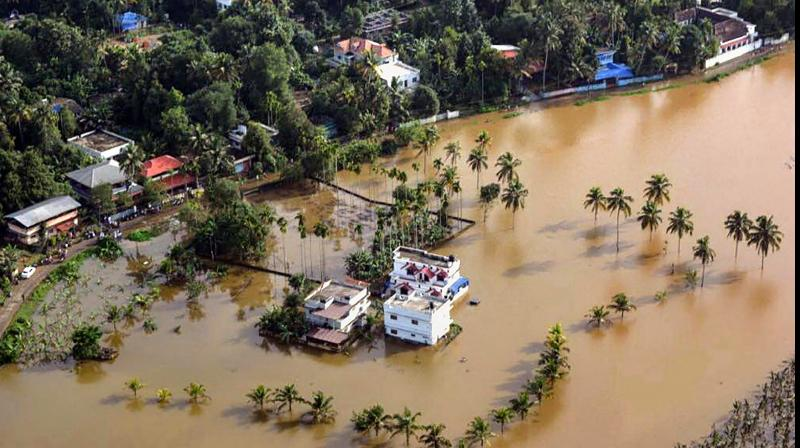 An aerial view of the flooded locality of Aluva after heavy rains, in Kerala on Friday. (Photo: PTI)