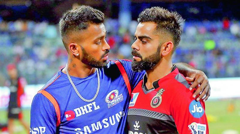 Mumbai Indians all-rounder Hardik Pandya (left) and RCB skipper Virat Kohli before their IPL match in Mumbai on Monday. (Photo: BCCI)