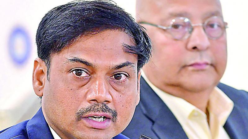 MSK Prasad (left), chairman of the senior selection committee announces the Indian team for the World Cup as BCCI secretary Amitabh Choudhary looks on in Mumbai on Monday. (Photo: AFP)