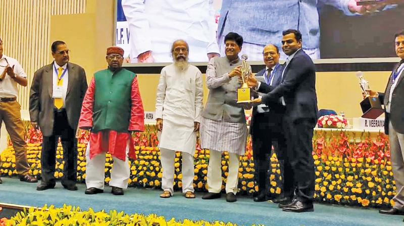 Managing partner of V V Minerals, V Subramanian, receiving the highest exporter award for the years 2015-16 and 2016-17 from Union commerce and industries minister, Piyush Goyel, at the CAPEXIL-organised function at Vigyan Bhawan in New Delhi. (Photo: M Aruloli)