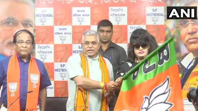 Bangladeshi film actress Anju Ghosh was handed over the BJP flag as she joined the party in presence of the party president Dilip Ghosh in Kolkata. (Photo: Twitter I ANI)