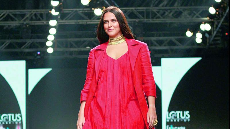 Neha Dhupia in a pleated dress and jacket by designer Nidhika Shekhar