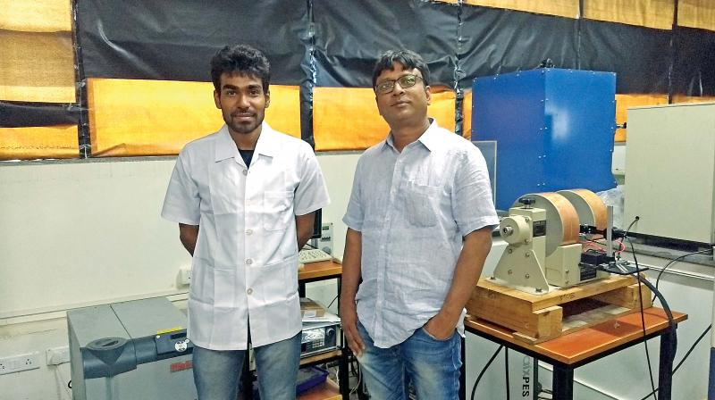 Dr Saket Asthana, head professor, Advanced Functional Materials Laboratory, Department of Physics,  IIT-Hyderabad, with one of his students.