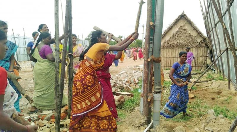 Cholavaram villagers vandalise motors used to illegally draw water from wells which they use for their agricultural lands. (Photo: DC)