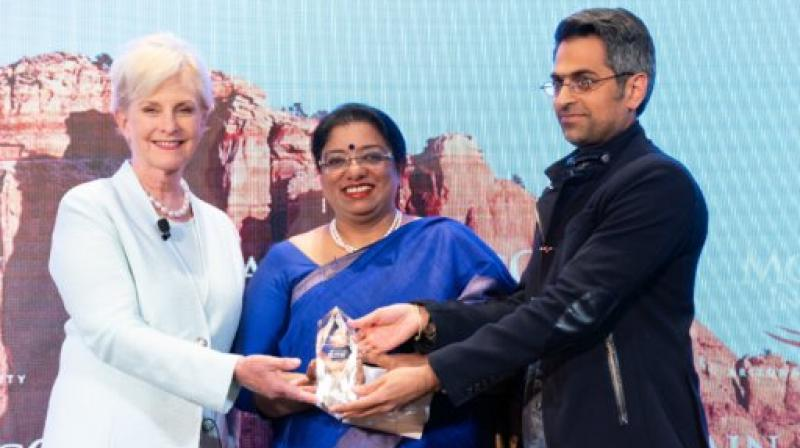 IPS Officer Chhaya Sharma (Centre) while receiving McCain Institute award for Courage and Leadership. (Photo: ANI)