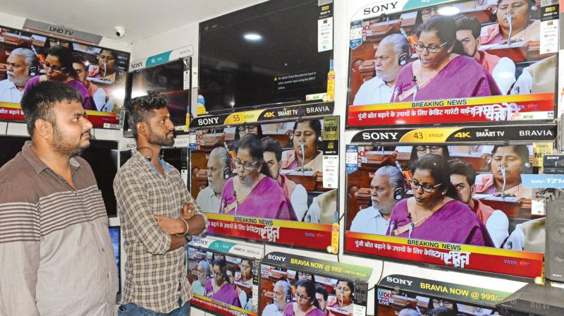People at a TV showroom in Purasawalkam watch Finance minister Nirmala Sitharaman presenting Budget, in Parliament on Friday. (Photo: DC)