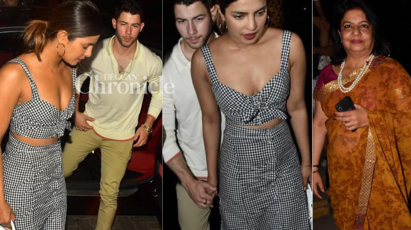Priyanka Chopra with rumoured boyfriend Nick Jonas and mother Madhu Chopra outside a restauarant at Bandra Kurla Complex. (Photos: Viral Bhayani/ Twitter)
