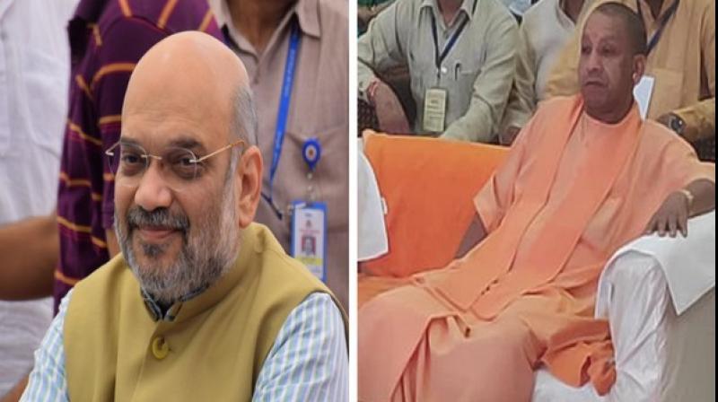 Shah was listening to the programme along with Delhi BJP chief Manoj Tiwari at Kakrola stadium in New Delhi's Dwarka area. (Photo: ANI)