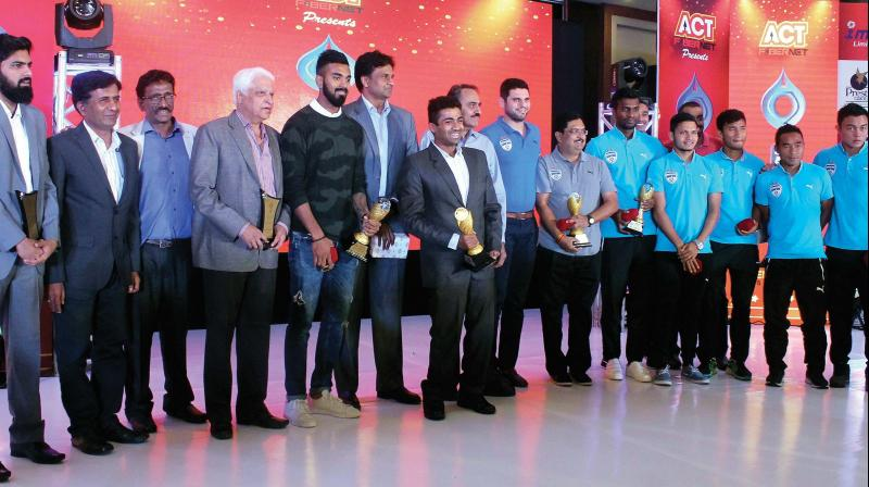 The awardees strike a pose with their spoils on Sunday. (Photo: DC)