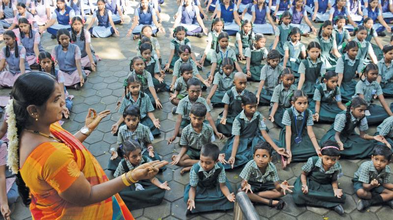 Students are taught yoga before school  assembly on Friday. (Photo: DC)