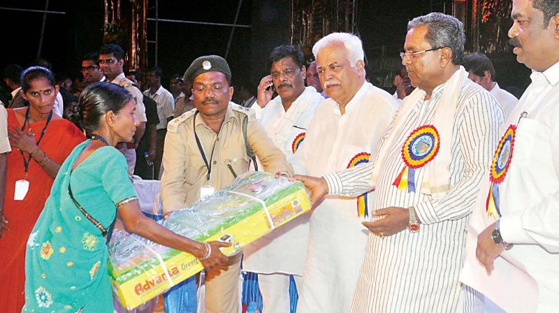 Chief MInister Siddaramaiah and Industries Minister R.V. Deshpande at the launch of developmental works in Uttara Kannada district on Wednesday. (Photo: DC)