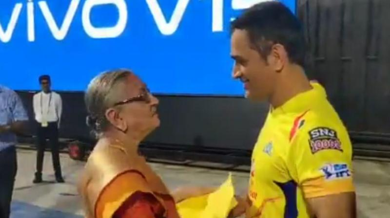 In a video uploaded on IPL's official Twitter handle, the 37-year-old can be seen greeting an old woman and interacting with her, while a young girl is also seen accompanying her. (Photo: Screengrab)