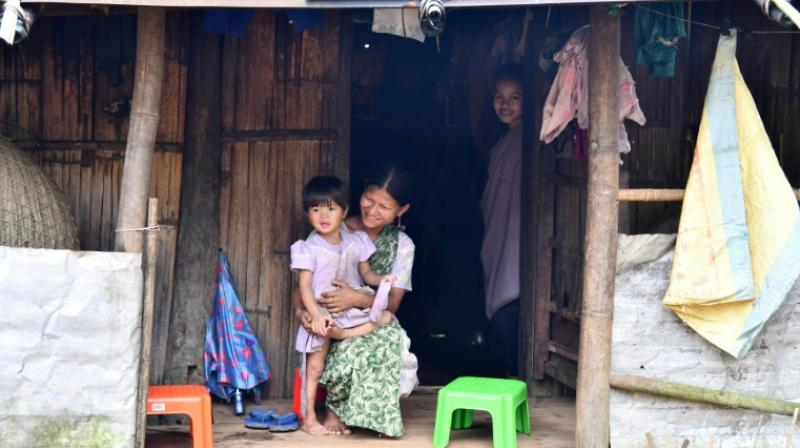 Kongthong has long been cut off from the rest of the world, several hours of tough trek from the nearest town. Electricity arrived only in 2000, and the dirt road in 2013. (Photo: AFP)