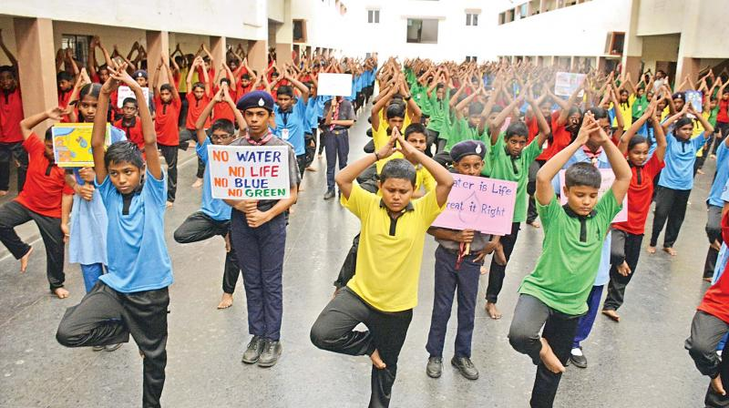 Students of Bhaktavatsalam Vidhyashram, Korattur, performing special yoga for rain in Chennai on Wednesday.  (DC)