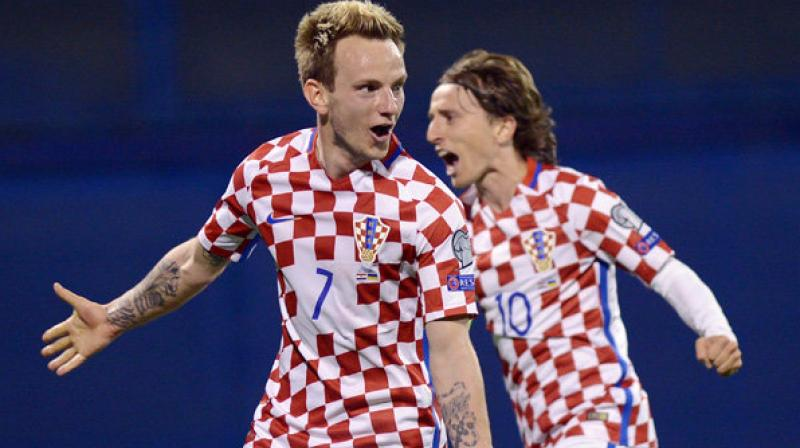 In possibly their last World Cup as midfield partners, Luka Modric and Ivan Rakitic were named Monday in the provisional Croatia squad for the tournament in Russia. (Photo: AFP)