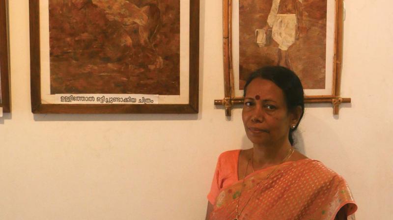 Sasikala near her paintings