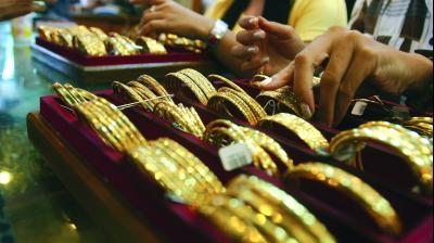 Globally, spot gold was trading lower at USD 1,402.80 an ounce in New York.