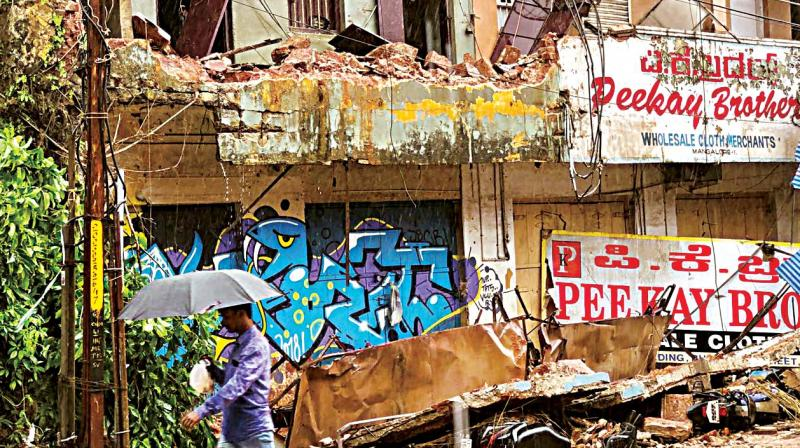 A building on Bhavanti Street in Mangaluru which was damaged as heavy rain lashed the city on Saturday.  (Photo:DC)