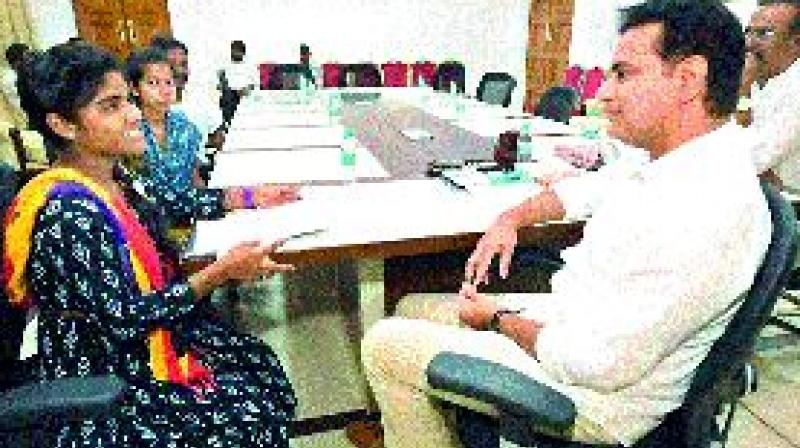 TRS working president K.T. Rama Rao interacts with two students who sought his help, at his office in Hyderabad on Thursday.