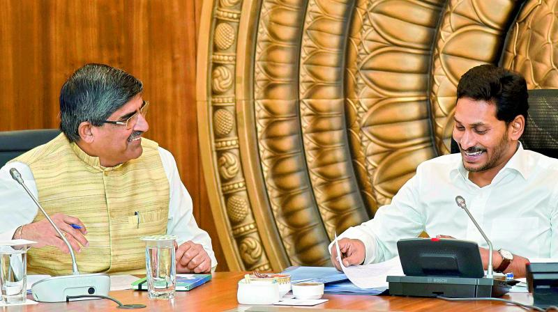 Chief Minister Y.S. Jagan Mohan Reddy shares a lighter moment with Chief Secretary L. V. Subramanyam at the Cabinet meeting in Secretariat on Thursday. (Photo: DC)