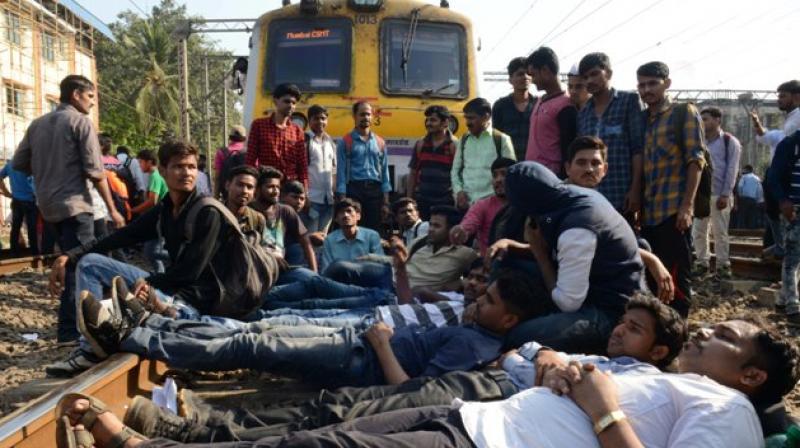 Mumbai-Students of All India Railway Act Apprentice Association stage blockade demanding jobs in railway sector near Dadar and Matunga. (Photos: Rajesh Jadhav)