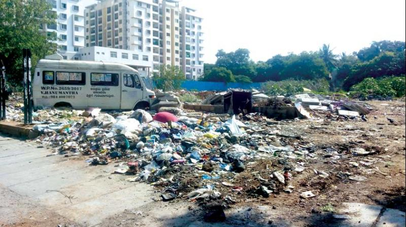Garbage dumped on a vacant site in BTM Layout	(Photo: DC)