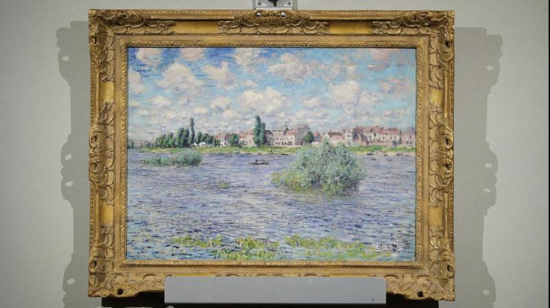 "Claude Monet's ""La Seine a Lavacourt"" hangs on display during an auction at Christies from the collection of Peggy and David Rockefeller, Tuesday, May 8, 2018, in New York. (Photo: AP)"